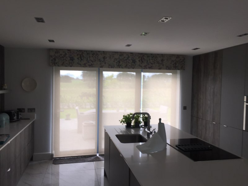 Pelmet over electric roller blinds