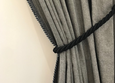 Angled curtains with trim